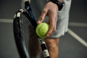 Man about to serve a tennis ball