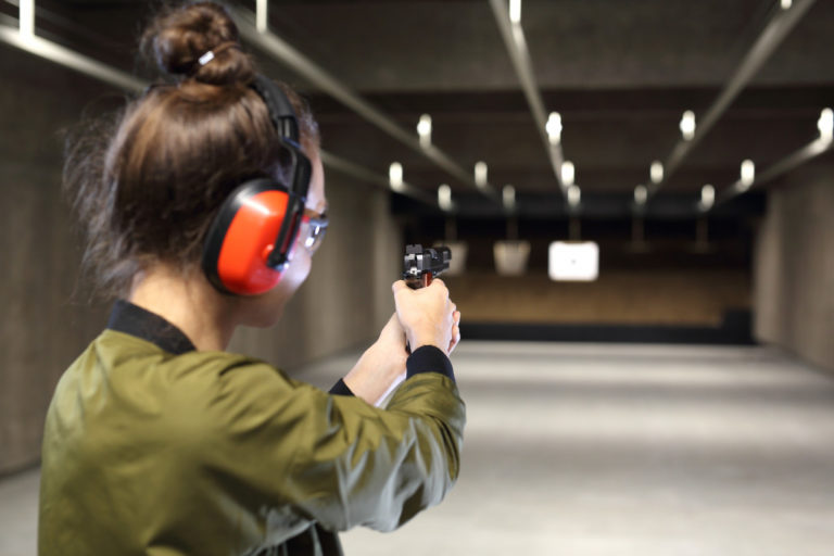 Female target shooting